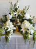 White Orchids & Lilies Surround (shown at $300.00)